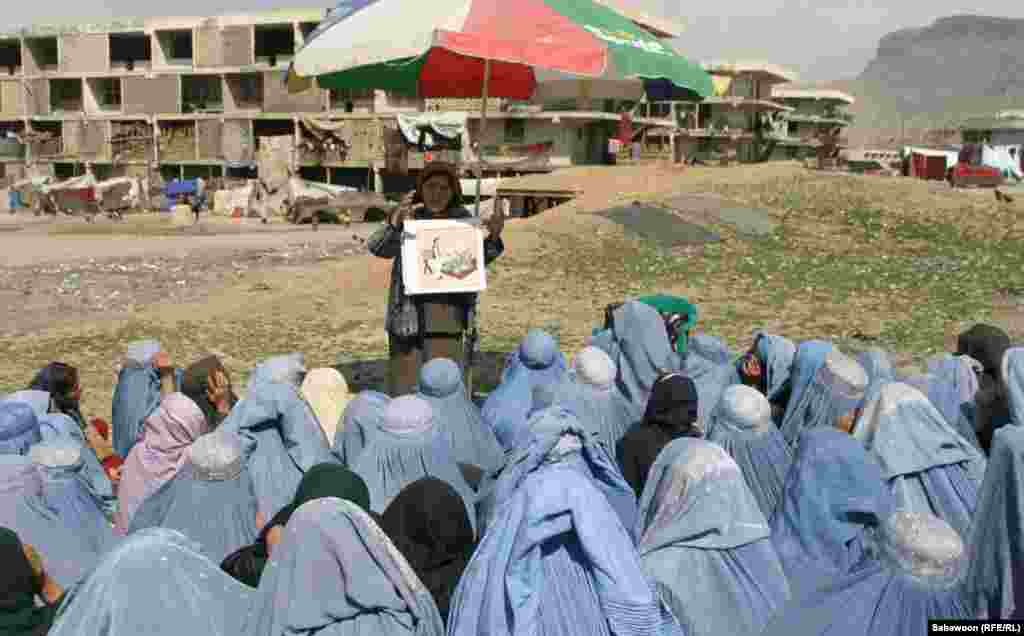 Female students attend an outdoor lesson.
