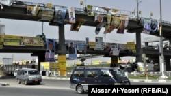 ملصقات دعائية لمرشحي إنتخابات في النجف