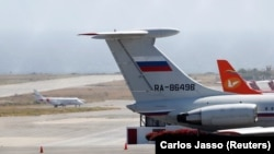 An airplane with the Russian flag is seen at Simon Bolivar International Airport in Caracas on March 24.