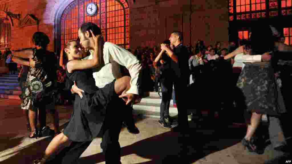 Couples perform the tango during a demonstration at the historic Haydarpasa train station in Istanbul, Turkey. (AFP/Ozan Kose)