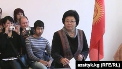 "President Roza Otunbaeva casts her ballot in Bishkek. ""We are prepared to face any challenges,"" she says."