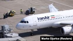 An IranAir Airbus A320 passengers aircraft parks after landing at Belgrade's Nikola Tesla Airport, March 13, 2018