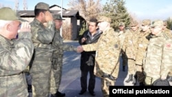 Turkey - Turkish officers (L) greet Armenian colleagues inspecting their army unit near Igdir, 28Nov2012.