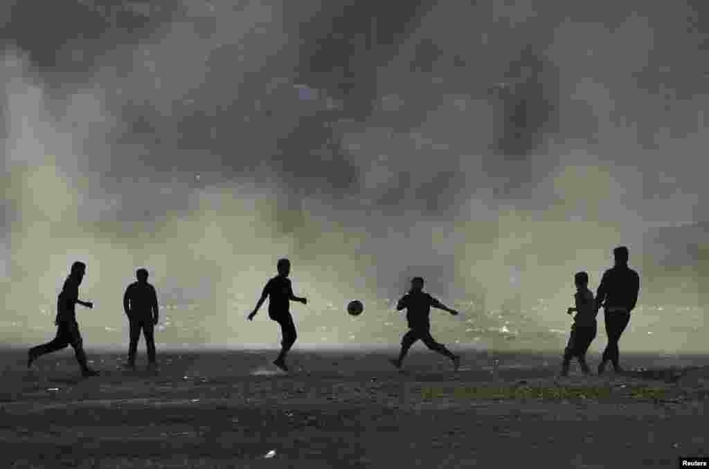 Afghan boys are silhouetted as they play football at dusk in Kabul. (Reuters/Mohammad Ismail)