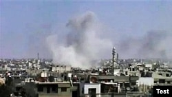 Smoke rises following purported shelling in Homs on April 10.