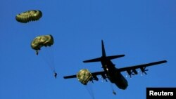 Paratroopers jump from a C-130 Hercules plane during NATO allies' Anakonda 16 exercise in June.