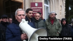 Opposition activists protest outside the de facto parliament of the separatist Georgian entity Abkhazia on January 10.