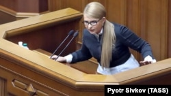 Yulia Tymoshenko calls for the impeachment of Ukrainian President Petro Poroshenko at a parliament session in Kyiv on February 26.