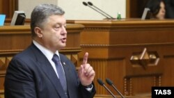 Ukraine – Ukrainian President Petro Poroshenko addresses deputies before voting for changes in the constitution on decentralizing power at the parliament in Kyiv, July 16, 2014
