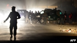Afghan police officers work at the scene of an attack on foreign troops in Kabul in October.