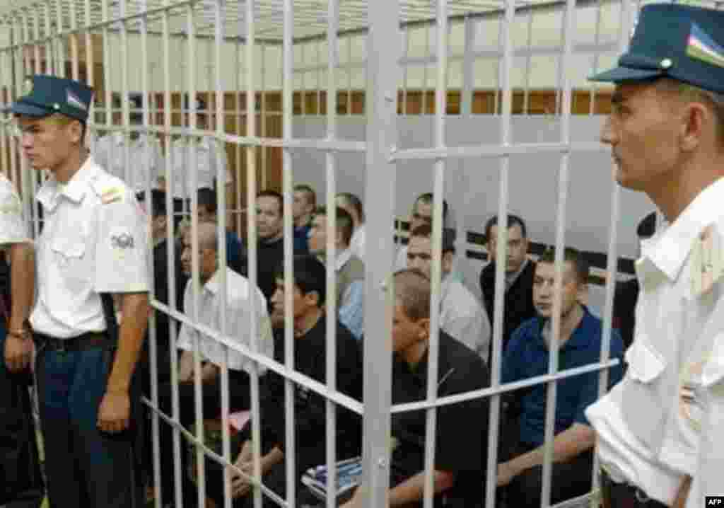 Fifteen Andijon defendants on trial at the Uzbek Supreme Court on terrorism-related charges in September 2005 - Scores of Uzbeks have faced prosecution since the Andijon events, including 15 defendants convicted of murder and terrorism-related charges in connection with the initial prison siege. But others with no ties to the original events have also been jailed on suspicious charges, including a number of journalists and human rights activists who investigated or publicized the Andijon bloodshed.