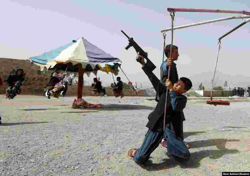 Afghan children ride a swing during the first day of the Muslim holiday of Eid al-Fitr, which marks the end of the holy month of Ramadan, in Kabul on June 15. (Reuters/Omar Sobhani)
