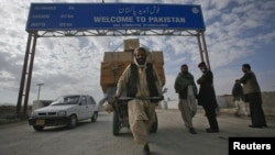 A Pashtun man passes the Pakistani-Afghan border crossing in Chaman, a border that Afghanistan believes is no one's business but the Pashtuns'.