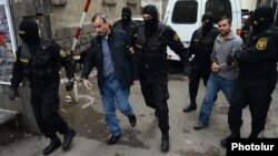 Armenia - Zhirayr Sefilian (L) and another detained leader of the Founding Parliament movement are taken to the Investigative Committee for further questioning, Yerevan, 9Apr2015.