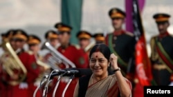 Afghanistan -- Indian Foreign Minister Sushma Swaraj speaks during a flag-raising ceremony with Afghan President Hamid Karzai in Kabul, September 10, 2014