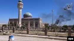 A video grab shows smoke rising in the city of Ramadi on May 18.