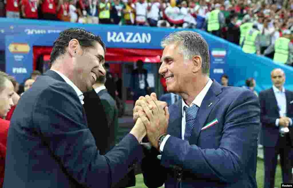 Soccer Football - World Cup - Group B - Iran vs Spain - Kazan Arena, Kazan, Russia - June 20, 2018 Spain coach Fernando Hierro shakes hands with Iran coach Carlos Queiroz before the match REUTERS/Sergio Perez