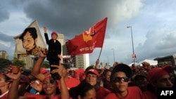 Supporters of Venezuelan President Hugo Chavez at a rally for United Socialist Party of Venezuela (PSUV) candidates in Caracas on September 23.
