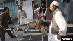 A man injured in the September 4 bomb blast is wheeled into a hospital in Jalalabad.
