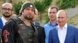 The leader of the Night Wolves, Aleksandr Zaldostanov (aka The Surgeon) and Russian President Vladimir Putin in Sevastopol, Crimea, in August 2017
