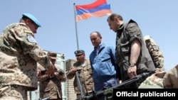 Afghanistan- Armenian Defense Minister Seyran Ohanian (C) and his first deputy Davit Tonoyan (R) inspect Armenian troops in Afghanistan, 24July 2010.