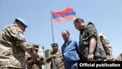 Armenia -- Defense Minister Seyran Ohanian inspects Armenian troops in Afghanistan, 24July 2010.