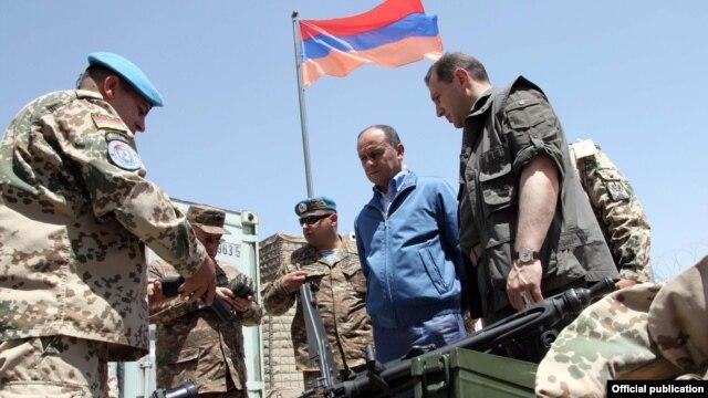 Afghanistan- Armenian Defense Minister Seyran Ohanian (C) and his first deputy Davit Tonoyan (R) inspect Armenian troops in Afghanistan, 24July 2010.