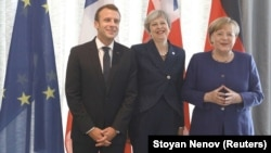 French President Emmanuel Macron (left), British Prime Minister Theresa May (center), and German Chancellor Angela Merkel meet during the EU-Western Balkans Summit in Sofia on May 17.