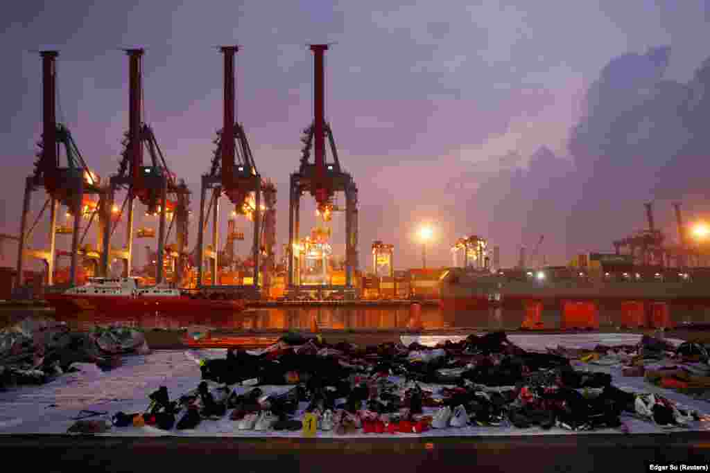 Recovered belongings believed to be from Lion Air Flight JT610, which crashed into the Java Sea shortly after takeoff on October 29, are laid out at Tanjung Priok port in Jakarta, Indonesia. All 189 people on board died in the crash. (Reuters/Edgar Su)