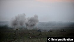 Nagorno-Karabakh - Tanks fire live rounds during a military exercise, 12Nov2013.
