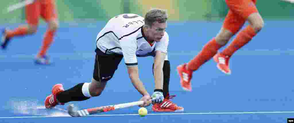 Germany's Matthias Muller plays against the Netherlands during their men's field hockey match.