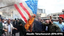 Iranians burn U.S. flag as they take part in an anti-U.S. rally after Friday Prayers to show their support of Iran's revolutionary guards corps (IRGC), in Tehran, April 12, 2019