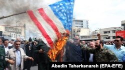 Iranians burn a U.S. flag as they take part in an anti-U.S. rally after Friday Prayers to show their support for the IRGC in Tehran on April 12.