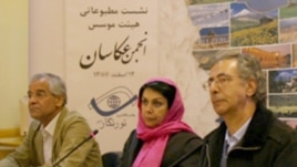 Maryam Zandi (center), the head of the National Society of Photographers