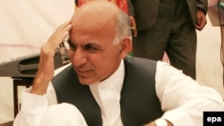 Presidential candidate Ashraf Ghani speaks to supporters in Kabul in June.