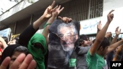 Opposition supporters chant slogans in support of Mir Hossein Musavi (in portrait), as they protest during a rally marking Quds (Jerusalem) Day in Tehran.