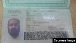FILE: The Pakistani passport the Afghan Taliban leader Akhtar Muhammad Mansur was carrying at the time of his killing in southwestern Pakistan in May 2016.