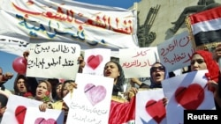 Iraqi women demonstrate against the lack of basic services in central Baghdad on February 14.