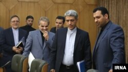 Center, Ali Tayebnia, minister of economy, to his right, Mohammad Baqer Nobakht, Management and Planning Organization of Iran and Valiollah Seyf, head of Iranian Central Bank, who was recently sacked. Oct 17th. Tehran.