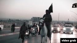 "Иракъ -- ""Исламан пачхьалкх"" тобано цхьа шо хьалха дуьйна дIалаьцна латтош ю Мосул. 2015. Манг."