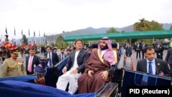 Imran Khan accompanies Prince Muhammad bin Salman on a carriage in Islamabad in February 2019.