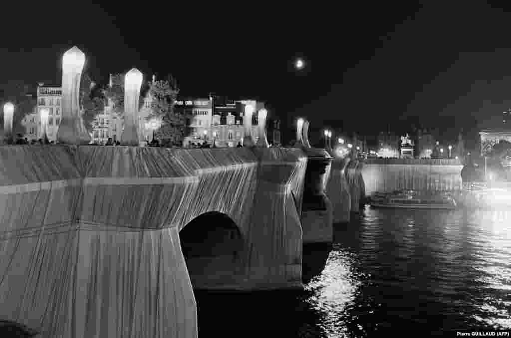 A view by night of the Pont Neuf in Paris, wrapped by Christo