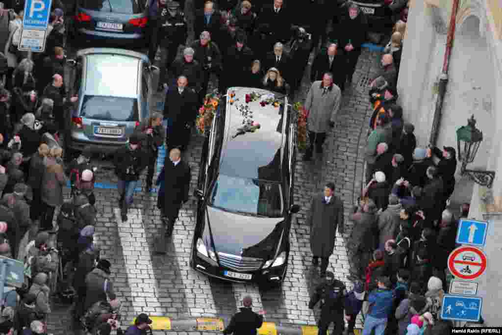 Havel's widow Dagmar (center), accompanied by her daughter Nina, lead the procession behind the hearse on its way to Prague Castle