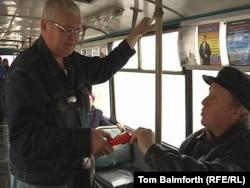 Aleksandr Zverkov (left) now works as a conductor on public transportation in Rybinsk.