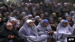 Nigeria -- A video grab shows girls, wearing the full-length hijab and praying at an undisclosed rural location, undated