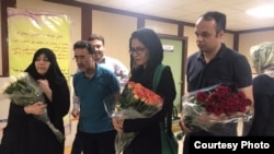 Rights activists at the hospital to visit opposition figure Karroubi. Security did not allow them in.