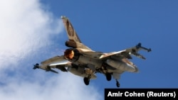 An Israeli F16 fighter jet takes off during a joint international aerial training exercise. FILE PHOTO