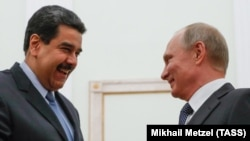 Russian President Vladimir Putin (right) meets with Venezuelan President Nicolas Maduro at the Kremlin in October 2017.