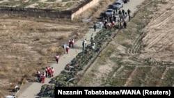 Тіла загиблих біля місця катастрофи, околиці Тегерану, 8 січня 2020 року