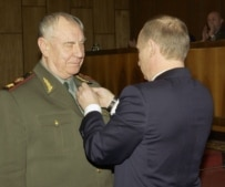 Putin awards a medal to Marshal Dmitry Yazov, one of the 1991 coup plotters (ITAR-TASS)